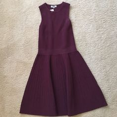 """Opening Ceremony Compact Knit Dress OFFERS ACCEPTED! Never been worn. Tags still on. Out of stock everywhere! Size - Medium. Maroon compact knit sleeveless dress styled with flared skirt. Rib-knit jewel neck and armholes. 35.25"""" from shoulder to hem (approx). Slips on. 73% viscose, 15% Elite, 12% spandex. Dry clean. Imported. Fits a size 6/8. Opening Ceremony Dresses Mini"""
