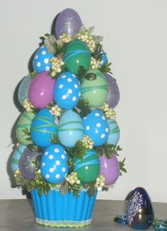 Handmade Whimsical, Adorable Easter Egg Topiary Tree, holiday decor. $45.00, via Etsy.
