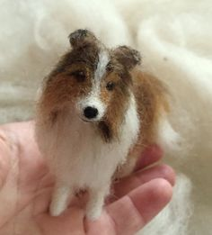 This little Sheltie is about 3.5 to inches from nose to tail.  The dog will be carefully created from natural fibers including wool and alpaca.