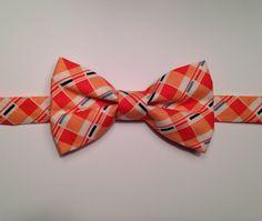 Little boy orange bow tie