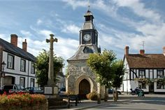 Mere, Wiltshire (Wilts), England  This is the Clock Tower in the old market square although markets are no longer held here. Just beyond, on the right, is part of the half-timbered George Inn and, on the left is the War Memorial