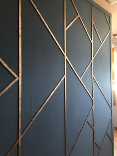 I love this wall treatment. It could add amazing visual interest to an accent wall and also carry the navy blue throughout the space