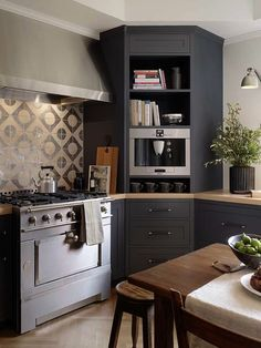 Gray kitchen cabinetry with cream countertops