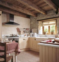 Wonderful-small-rustic-kitchen-design-with-rough-stone-and-wood-window-decoration.jpg