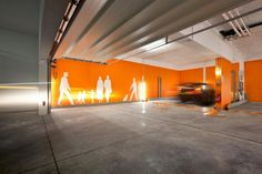 Architecture, Cement Flooring Tile Basement Garage Modern House Design With Orange And White Interior Color Decorating Ideas Plus Wall Painting Art: The Stunning Housing Building of Seven Units in Kirchberg Garage Paint Colors, Interior Paint Colors, Garage Interior, Interior Photo, Interior Design, Cool House Designs, Modern House Design, Parking Design, Signage Design