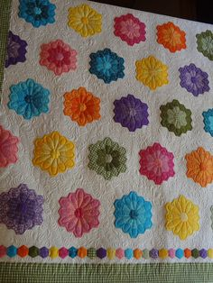 Stunning quilting that almost completely hides the fact that these are made from hexagons.