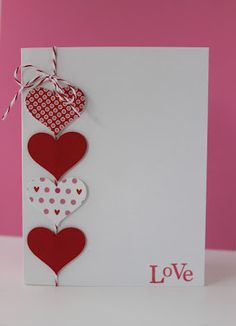 handmade valentine ... clean and simple ... pick out some great red and white printed paper ... punch four hearts ... attach in a row on red & white bakers' twine ... stamp a sentiment .. lu this card!!