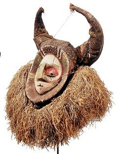 "YAKA, MASK, 28"", Wood, cloth, paint and raffia Photograph © Tim Hamill"