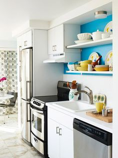 Open kitchen shelves. I like the idea of painting a bright colour only behind the shelves. Similar to this BA xxx