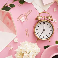 Pink Instagram flatlay inspiration. | White flowers, envelope stationery, gold paper clips, with vintage copper clock. | From sparkedpassion on Instagram.