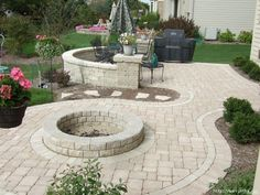 Patio Ideas For Backyard paver patio with grill surround, fire pit and stone steppers that