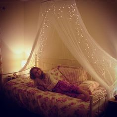 Megan's new vintage daybed with floral bedding and fairy light canopy