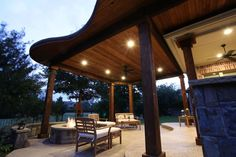Add on to your covered patio with a beautiful radius cut cedar pavilion. By Outdoor Signature in Argyle, TX