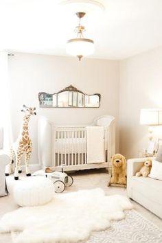 Elegant, all-white nursery room - Photo via Farewell and Nest.