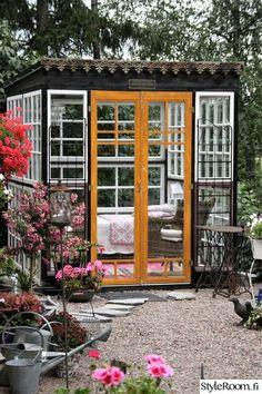 Lovely gazebo made from old doors & windows
