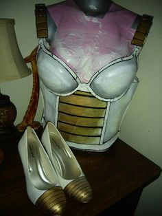 Female Saiyan (vegeta) armor and pumps. Armor made from bra and craft foam, gold and white spray paint, zipper back, mod podge, i used fabric stiffener on the bra instead of resin. It works much better and isn't messy it made the bra rock hard. Also used 3D paint for the edges but be warned it's pretty messy. To make it look worn i just used acrylic paint and smeared the black 3D paint. Finalized with clear sealer. (Glued everything with hot glue- no sew.)  Side note, i do not recommend…