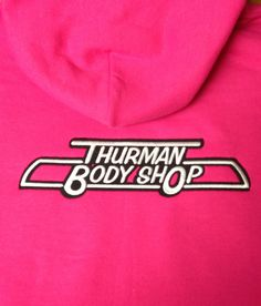 Thurman Body Shop on the back of a hoodie.  Embroidery by Top It Off.