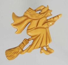 Large butterscotch Bakelite witch pin -- no info as to whether this is a vintage or contemporary piece.