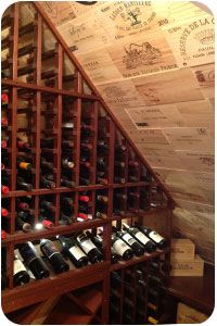 Small walk-inwine room with curved corner wine racks.
