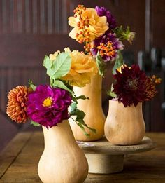 Gourd vases.  This would be fabulous table decor for your fall dinner party.  It would also be great with pumpkins. autumn-aspirations