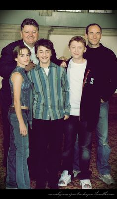 Emma Watson, Daniel Radcliffe, and Rupert Grint posing with Robbie Coltrane and Jason Isaacs