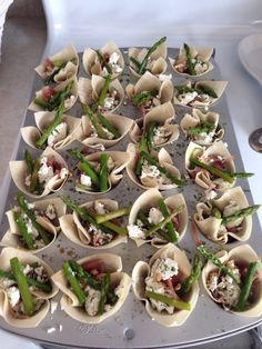 New creation, goat cheese,  Prosciutto, blanched asparagus, dry dill and parsley and balsamic vinegar in wonton wrappers