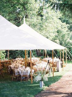 beautiful tent + reception setting .
