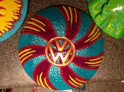 """Original art on a VW hubcap by Stovepipe, entitled """"Whirly Gig"""""""