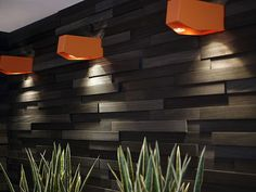 START PEOPLE Flagship Office  Love the textured wall and orange lighting