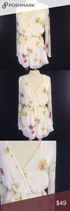 """[Millibon USA] L Floral Sheer Romper Sleeves -Size large -Flower print -Large Bell sleeves -V-neck wrap style shorts romper -100% polyester  Measurements: Pit to Pit 17"""" Waist 12- 20"""" not stretched to stretched Sleeve Length 18"""" Length 30""""  We are open to reasonable offers on any of our items & offer bundle discounts! Millibon Pants Jumpsuits & Rompers"""