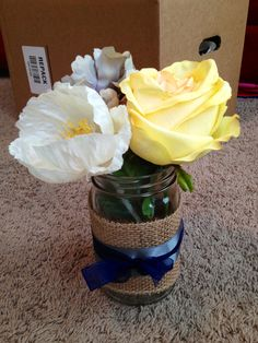 Wedding centerpieces in yellow, blue, and grey