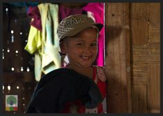 Smiles of Myanmar. I met this girl near Inle Lake. We were trekking with a guide in the mountains and we stopped in a bamboo hut to rest and eat something. He knew the family living there and they cooked us a delicious Burmese meal while this girl, shy at the beginning, played hide and seek with us.