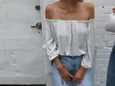 white off the shoulder top with light wash high wasted jeans. brandy melville style.