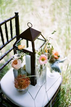 Rustic Lantern and Wildflower Centerpieces | Last Petal a Floral Studio | Christianne Taylor Weddings | TheKnot.com