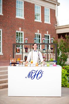 Such a cute idea- monogrammed counter cover for the bar.  Photo by Ely Fair Photography.  www.wedsociety.com  #wedding #decor