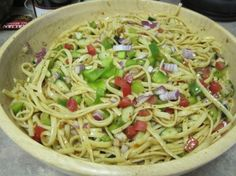 This is a recipe a neighbor passed to my mother about 30 years ago.  The color and presentation are so awesome, it's a very popular picnic/potluck meal.  No perishable ingredients means that it's great to sit out on a hot day, although it's best served nice and cold!