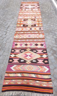 *** Worldwide Free shipping Kilim rug, approximately 30 years old. Never used. It was woven in Malatya, Turkey. The main colors are Pink, Purple, Tangerine,