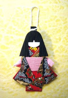 Small doll for hanging