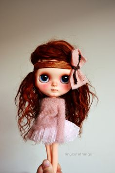 Merida, a custom doll who is adorable and charming.