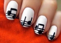 Musical nails  You paint it white, and then make little black lines for the staff lines, and then use the head of a pin to make the round part of the note, and then draw a line for the rest of the note.