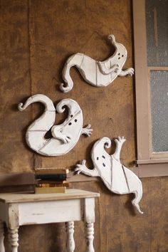 set of three painted wooden ghost wall or tree hangings