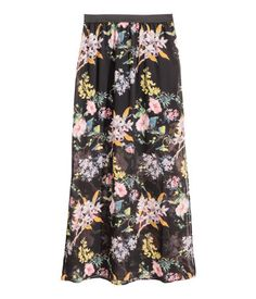 Black/Floral. Long chiffon skirt with an elasticated waist, high slits in the sides and a short jersey underskirt.