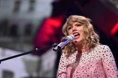 Taylor Swift performing 'Love Story' at the 2014 iHeartRadio Music Festival