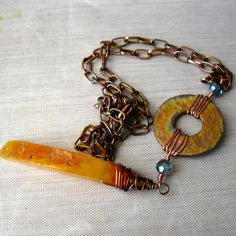 Gorgeous Red-Orange Agate gemstone and copper come together to create an one of a kind, Boho style long copper and gemstone necklace. Copper chain and donut have been flame painted as well as the w. Copper Necklace, Copper Jewelry, Gemstone Necklace, Wire Jewelry, Unique Jewelry, Agate Gemstone, Hippie Chic, Wire Wrapped Jewelry, Statement Jewelry