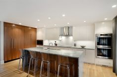 Contemporary walnut & lacquer kitchen by Johnson & Associates Interior Design