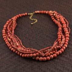 @Overstock - Handcrafted by artisans in India, this necklace comes in a beautiful color. The multi-strand necklace is a made of red wood beads and secures with a lobster claw clasp.  http://www.overstock.com/Worldstock-Fair-Trade/Wood-The-Coral-Look-Multi-strand-Beaded-Necklace-India/6053703/product.html?CID=214117 $24.99