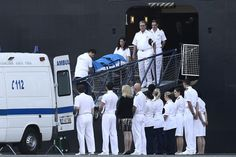 RETRIEVED: Emergency services removed the body of British broadcaster Sir David Frost from the Queen Elizabeth cruise ship in Lisbon Tuesday. Mr. Frost, 74 years old, who gained fame from interviews with U.S. President Richard Nixon and others, died of a heart attack while on board. (Pedro Nunes/Agence France-Presse/Getty Images)