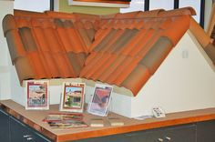 A clay tile roofing display at the Scudder Roofing Showroom.