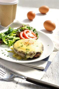 Sunshine Breakfast - baked mushroom caps lined with pasta (or pizza) sauce, then an egg and topped with cheese. 5 minutes prep. Yum!
