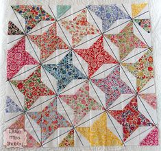 STASHBUSTER STARS. Squares and half-square triangles are sewn together to create diagonally traveling stars. Quilting lines cross at star points. 'Love the outcome! Tutorial at this site.